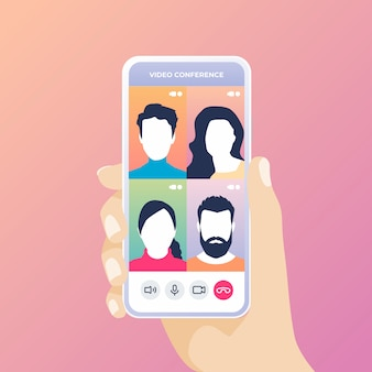 Hand holding phone talking together on video conference app phone call.