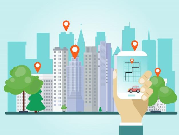 カーシェアリングアプリで携帯電話を持っている手。手は都市の位置マークを共有するスマートフォンを保持します