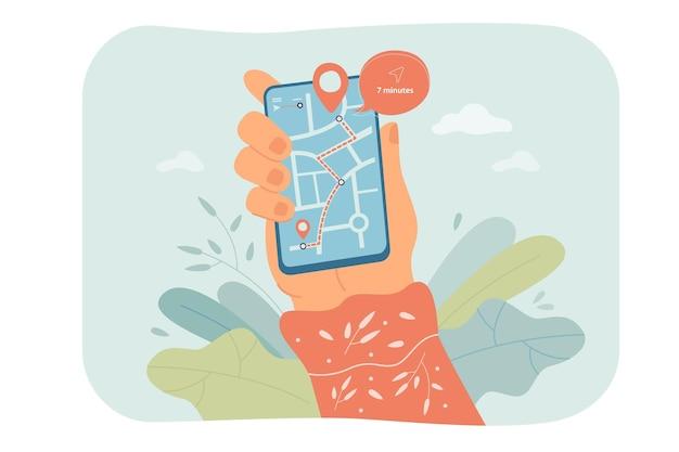 画面の平らな図に地図と携帯電話を持っている手