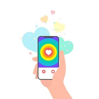 Рука держит телефон с приложением онлайн знакомств лгбт
