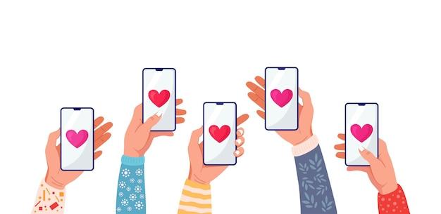 Рука телефон с красным сердцем. отправка любовных сообщений на смартфон.
