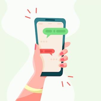 짧은 메시지, 아이콘 및 이모티콘이 있는 손을 잡고 전화. 친구와 채팅하고 새 메시지를 보냅니다. 스마트폰 화면 평면 디자인 벡터 일러스트 레이 션.