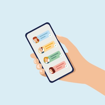 ショートメッセージのアイコンと絵文字が付いた携帯電話を持っている友達とチャットして送信する