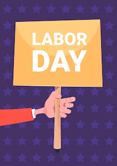 Hand holding placard labor day holiday