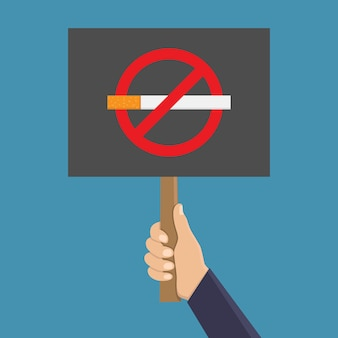 Hand holding signboard to stop smoking