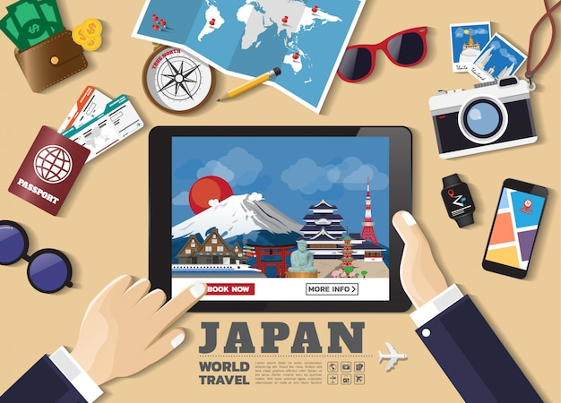 Hand holding smart device booking travel destination. japan famous places.