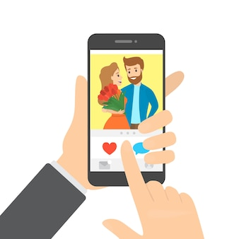 ハートボタンを押すアプリでスマートフォンと写真が好きな手。ソーシャルネットワークのアイデア。図