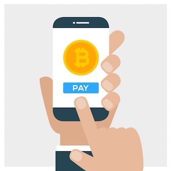 Hand holding smartphone and pay with bitcoin