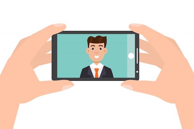 손 잡고 스마트 폰 및 복용 사진, selfie.
