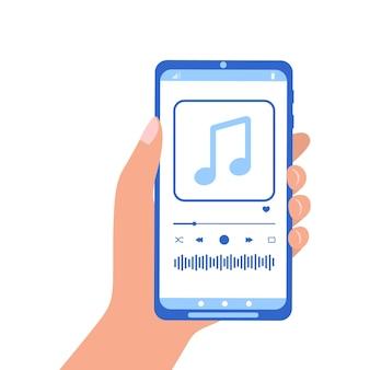 화면에 오디오 플레이어 인터페이스가 있는 스마트폰을 들고 있는 손
