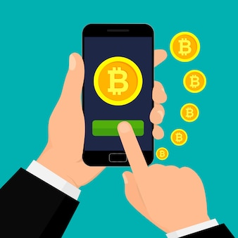 Hand holding smartphone with bitcoin currency.