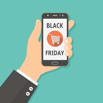 Hand holding smartphone with black friday sale on screen