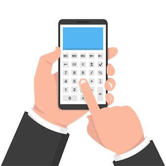 Hand holding smartphone with calculator