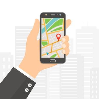 スマートフォン画面上の市内地図gpsナビゲーターとスマートフォンを持っている手