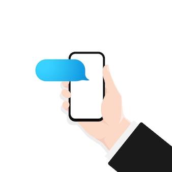 ダイアログウィンドウのイラストとスマートフォンを持っている手。空白のメッセージ。バブルスピーチ