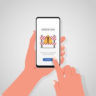 画面にエラーメッセージ記号が付いたスマートフォンを持っている手。