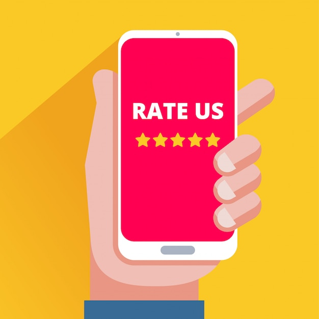 Hand holding smartphone with five star rating on screen