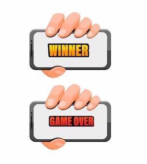 漫画イラストのゲームアプリのコンセプトのテキスト上のゲームとスマートフォンを持っている手