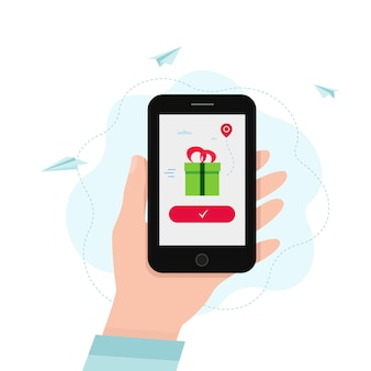 Hand holding smartphone with gift box on a screen.