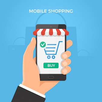 Hand holding smartphone with shopping cart and button on the screen.