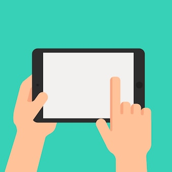 Hand holding tablet and pointing on the screen