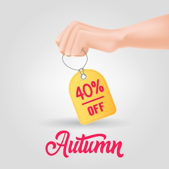 Hand holding tag with autumn, forty percent off lettering