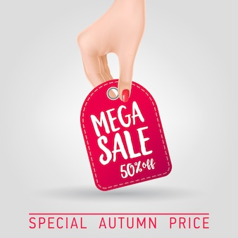 Hand holding tag with mega sale lettering