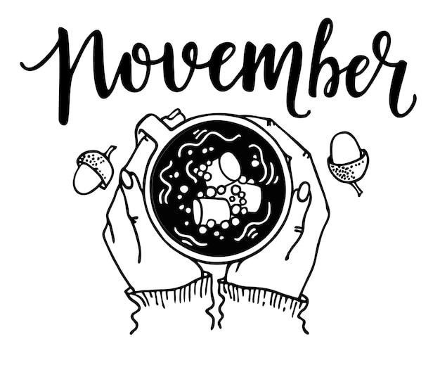 Рука держит теплый кофе или какао с зефиром и надпись ноябрь вид сверху уютный теплый