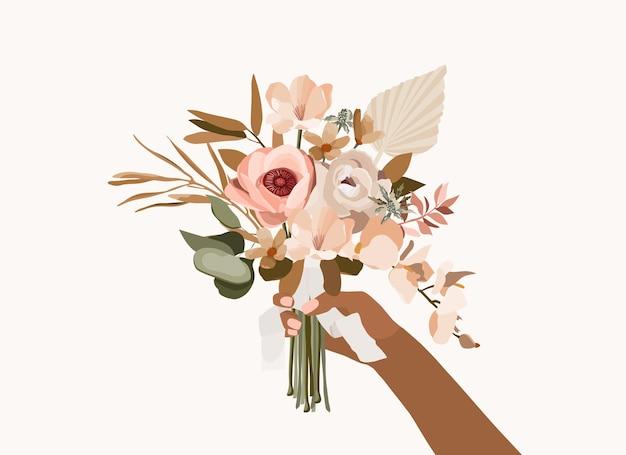 Рука держит свадебный букет