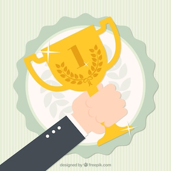 Hand holding winner cup