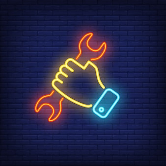 Hand holding wrench. Neon sign element