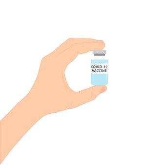 손에 코로나 19 백신이 든 병이 있습니다. 예방 접종.