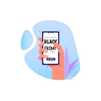 Рука держит телефон с надписью - черная пятница.