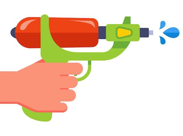 手はプラスチック製の水鉄砲を持っています。水を撃ちます。平らな