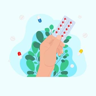 손에는 알약 캡슐, 약 개념, 질병 치료 개념의 물집 정제 팩이 있습니다. 주입 주사기. 의학 의료 개념입니다. 의료 배경
