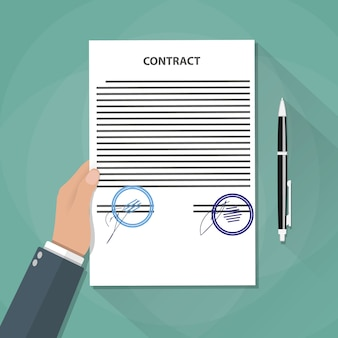 Hand holds contract documents