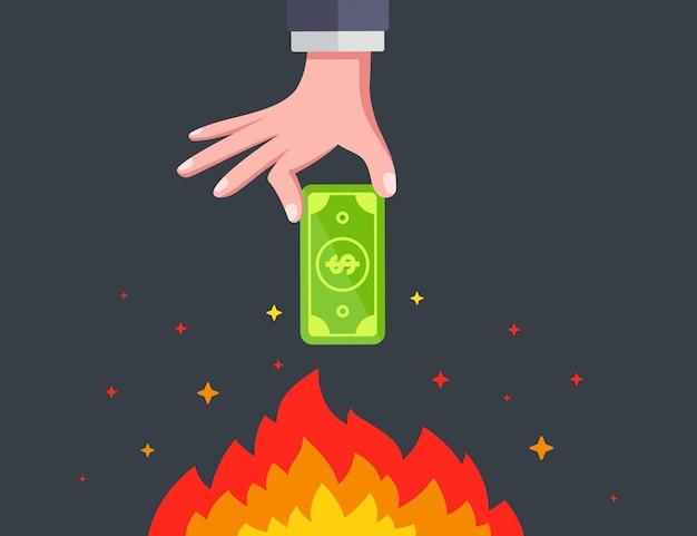 Hand holds dollar bill over bonfire. burning money. flat vector illustration