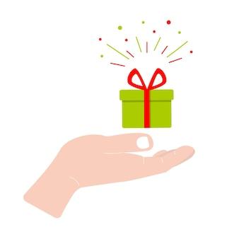 Рука держит подарочную коробку концепция поздравления