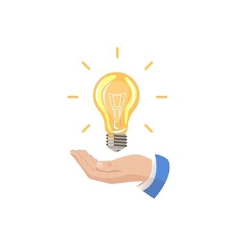 The hand holds a light bulb.
