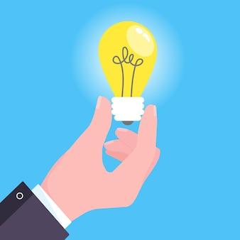 Hand holds lightbulb icon sign flat style design vector illustration