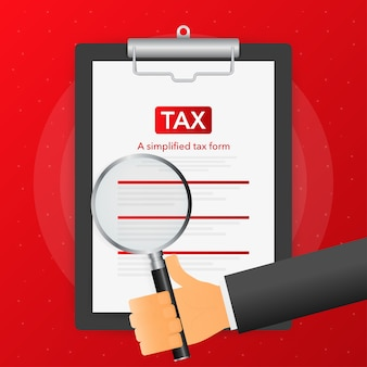 Hand holds magnifying glass over tablet with tax form on red background.