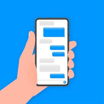手は青い背景にチャットメッセージと電話を保持します