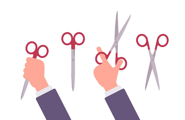 Hand holds scissors