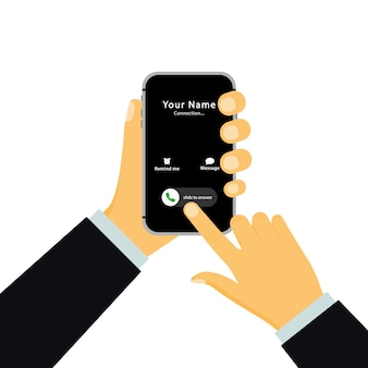 Hand holds a smartphone with an incoming call and a touch screen