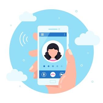 手は画面上に発信通話でスマートフォンを保持します。通話サービスの概念。