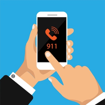 Hand holds smasrtphone with 911 number on a screen.