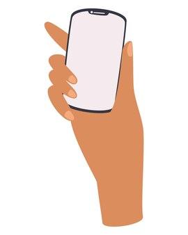 손은 전화를 보유하고 있습니다. 빈 흰색 화면이 있는 스마트폰.