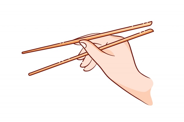 A hand holds wooden sticks for sushi and rolls.