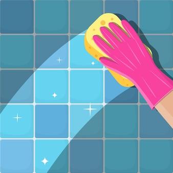 Рука в перчатках с губкой вымыть стену в ванной или на кухне. услуги по уборке. губка для мытья рук