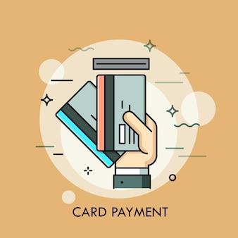 신용 카드 또는 직불 카드를 슬롯에 손으로 삽입합니다. 결제 방법, 출금, atm 서비스, 거래 개념